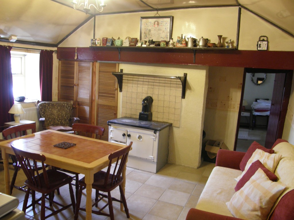 The front room (sitting room, kitchen, family room) of the original cottage