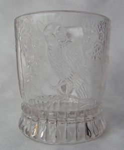 """Bird on a Branch (Size: 2-7/8"""" dia. x 3-3/8"""" ht.; Color: Clear) Directly opposite from the handle, the sculpting shows an owl perched on a branch."""
