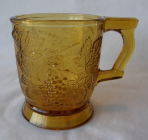 """Grape Bunch; handle at right (size: 3"""" diameter x 3-3/8"""" height; color: amber)"""