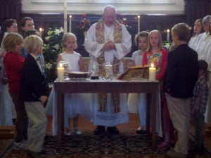 Fr. Funston assisted at the Communion Table by children of St. Paul's Parish